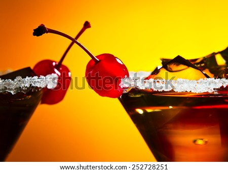 cocktail with cherry , sugar and ice , focus on berry - stock photo