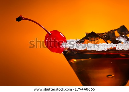 cocktail with cherry , sugar and ice , focus on cherry - stock photo