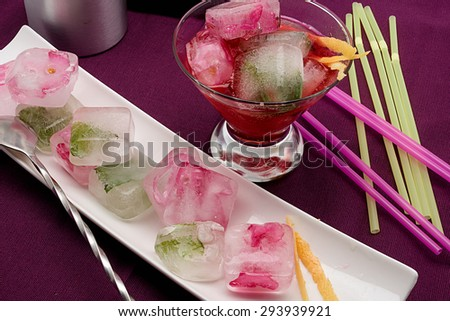 cocktail with Flower Ice Cubes composition - stock photo