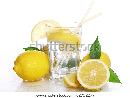 Cocktail with fresh wet lemons on white background - stock photo