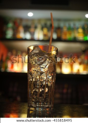Cocktail with ice and straw  - stock photo