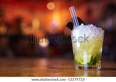 Cocktail with lime and ice in a glass - stock photo