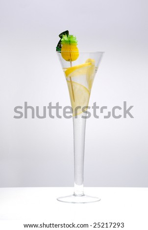 cocktail with lime isolated on the white