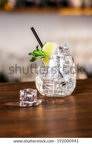 cocktail with lime, mint and ice - stock photo