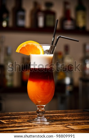cocktail with orange on bar table