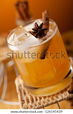 Cocktail with Rum, Apple Juice and Cinnamon Syrup - stock photo