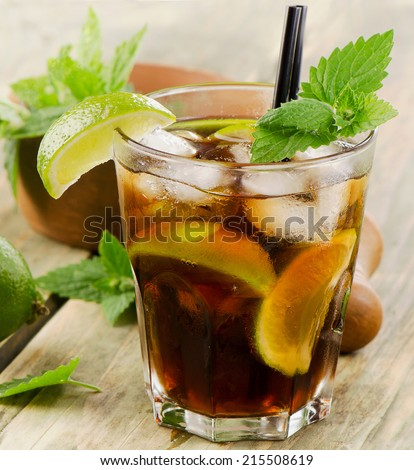 Cocktail with rum, lime, fresh mint  and ice. Selective focus - stock photo