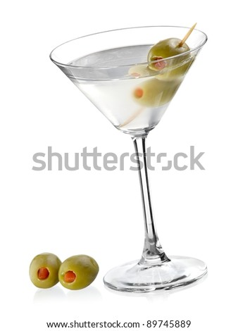 Cocktail with two green olives - stock photo
