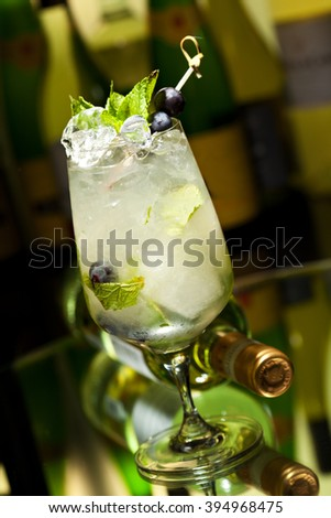 Cocktail with Vodka and White Wine, Grapes, Various Syrup, Lime Juice, Apple Juice and Mint - stock photo