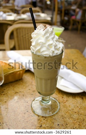 cocktail with whipped cream and irish coffee - stock photo