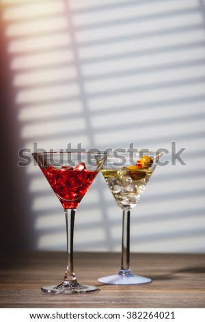 Cocktails in Art Deco glasses at the bar - stock photo