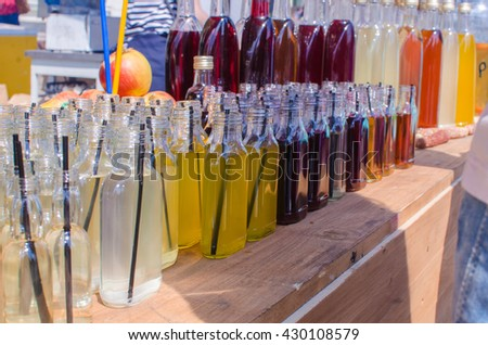 cocktails in small bottles . Cocktails at the summer bar. Summer bar . bottles with straws colored cocktails - stock photo