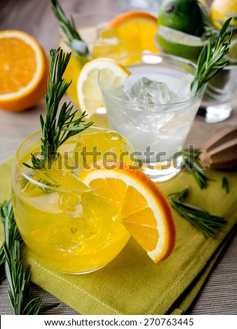 Cocktails made of gin, orange juice and tonic - stock photo