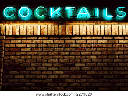Cocktails neon sign above an old brick wall with copyspace available - stock photo