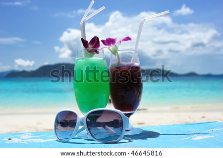 Cocktails on a beautiful beach - stock photo