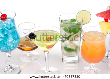 Cocktails with alcohol. Many drinks beverages Blue hawaiian, mojito; Sex on the beach, tropical  Martini, tequila sunrise, margarita, and cognac glass, cocktail umbrella, cherry, lime and pineapple - stock photo