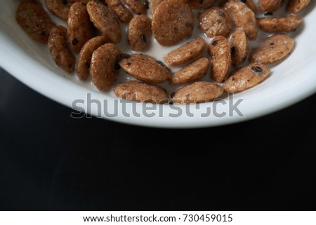 Coco crunch stock images royalty free images vectors shutterstock coco crunch and milk with white bowl isolated on black background ccuart Choice Image