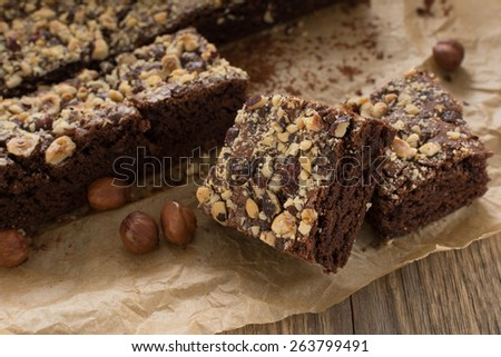 Cocoa and chocolate brownies dessert with hazelnut - stock photo
