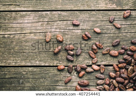 cocoa beans on old wooden table - stock photo