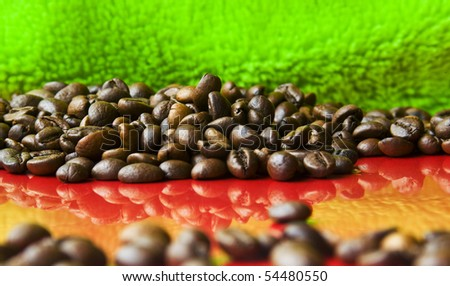 cocoa beans on red and green background - stock photo