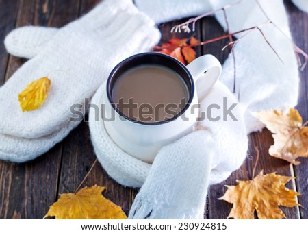cocoa drink in cup and on the table - stock photo