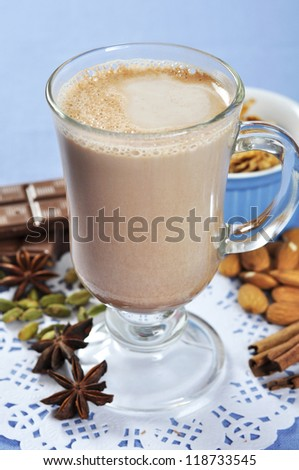 Cocoa in a glass cup closeup with chocolate and spices - stock photo