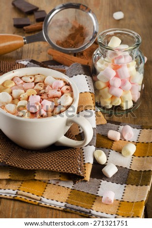 cocoa in white mug with on a wooden background selective focus