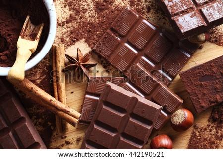 cocoa powder and chocolate bar - stock photo