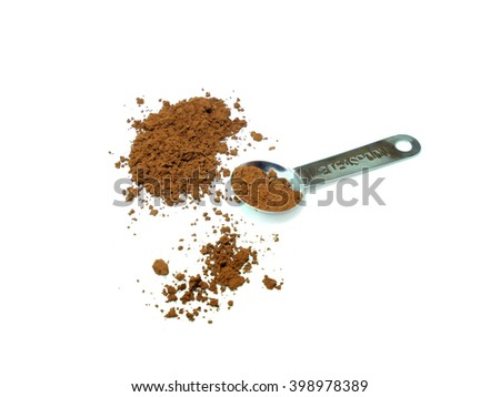 Cocoa powder and measuring spoon isolated on white background - stock photo