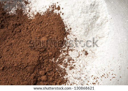 Cocoa powder and milk powder in a bowl - stock photo