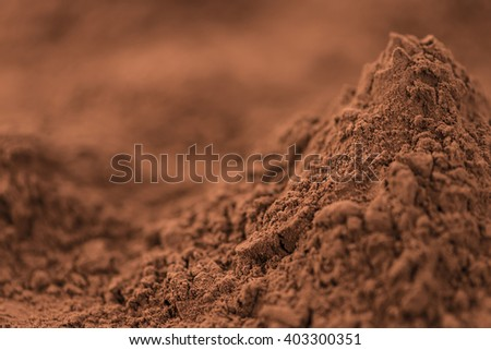 Cocoa powder(close-up shot) for use as background image or as texture - stock photo