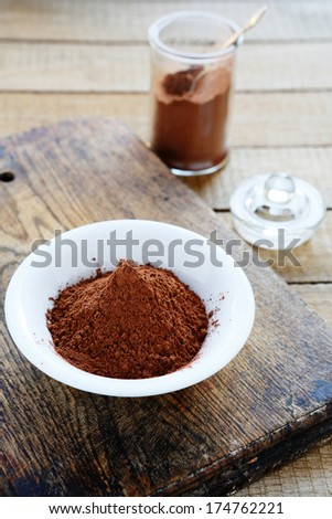 cocoa powder in a bowl and jar, food - stock photo