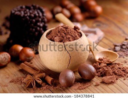 cocoa powder in a small bowl on the table - stock photo