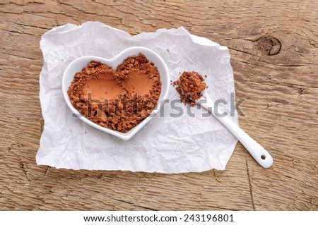 cocoa powder in shape of heart - stock photo
