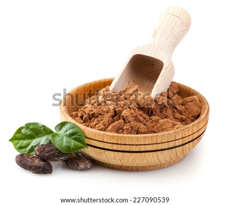 Cocoa powder in wooden bowl with cacao beans and green leaves isolated on white background