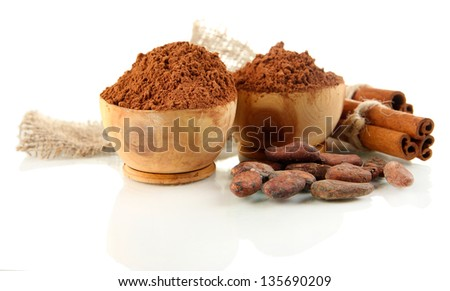 Cocoa powder in wooden bowls and spices, isolated on white - stock photo