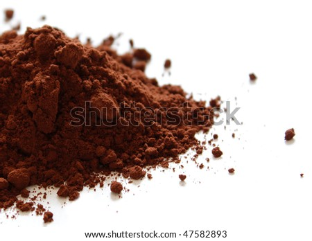 Cocoa powder isolated on white - stock photo