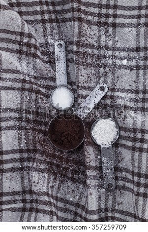 cocoa powder, sugar, cake flour, in spoons on  silk  food ingredient - stock photo