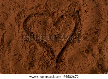 cocoa powder with heart as background - stock photo