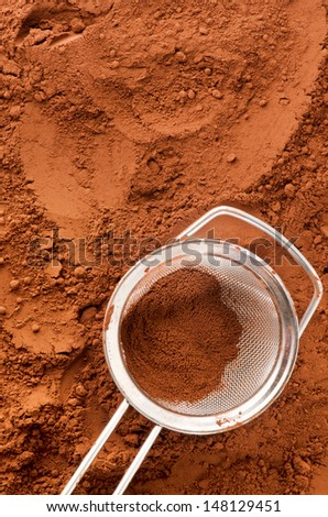 Cocoa powder with sieve and copy space