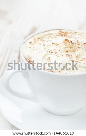 cocoa with cinnamon and whipped cream close-up, vertical