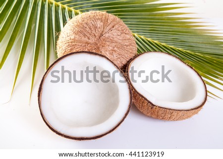 Coconut and leaves on white background - stock photo