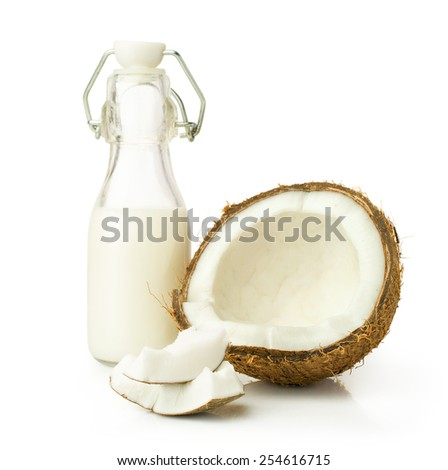 coconut and milk in a glass bottle isolated on white - stock photo