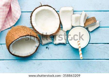 coconut and milk on kitchen table - stock photo