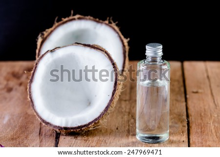 coconut and oil for natural spa on wooden - stock photo