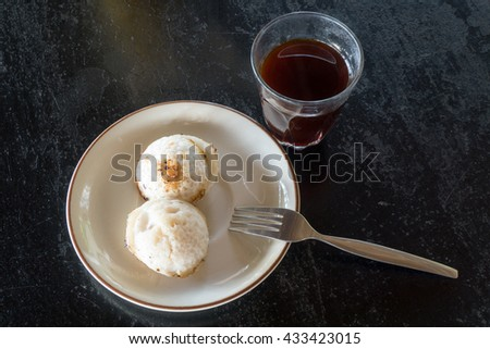 Coconut and rice hot cake (Serabi) with Thai tea - stock photo