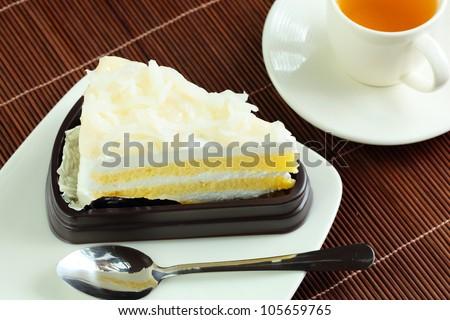 Coconut cake and tea. - stock photo