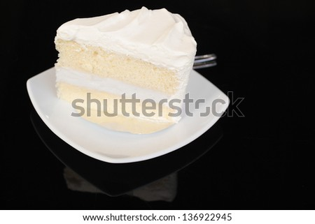 Coconut cake on black  glass background - stock photo