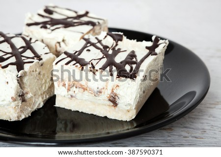 Coconut cake on plate - stock photo