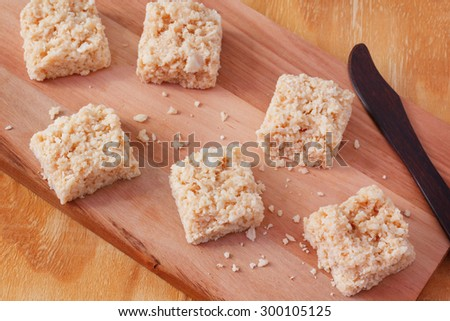 Coconut candy cocada on wooden board. Selective focus